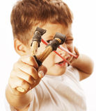 Little cute angry real boy with slingshot isolated Royalty Free Stock Photos