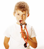 Little cute angry real boy with slingshot isolated. On white background close up stock photo