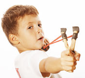 Little cute angry real boy with slingshot isolated. On white background close up royalty free stock photos
