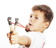 Little cute angry real boy with slingshot isolated. On white background close up royalty free stock photo