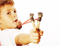 Little cute angry real boy with slingshot isolated. On white background close up stock image
