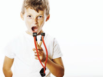 Little cute angry real boy with slingshot isolated. On white background close up royalty free stock images