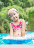 Little cute Asian girl on bikini suit Royalty Free Stock Photography