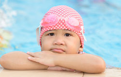 Little cute Asian girl bore to swimming Stock Photo