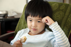 Little cute asian girl eating Stock Images