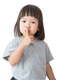 Little cute asian girl say be quie over white background. Royalty Free Stock Photography