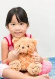 Little cute asian gril hug teddy bear Royalty Free Stock Images