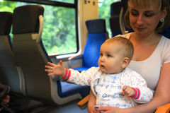 Little cute baby with blue eyes, traveling Stock Photo