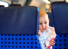Little cute baby with blue eyes, traveling Stock Image