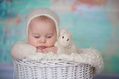 Little cute baby boy, dressed in handmade knitted white teddy be Royalty Free Stock Images