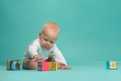 Little cute baby boy playing with color blocks Stock Image
