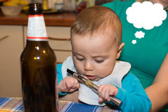 Little cute baby boy takes cigarettes Royalty Free Stock Photos