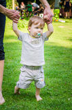 Little cute baby boy  walking with mother in park Royalty Free Stock Photography