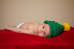 Little cute baby with christmas tree hat Royalty Free Stock Photography