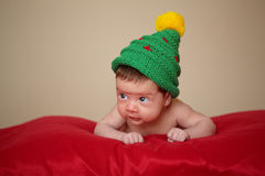 Little cute baby with christmas tree hat Royalty Free Stock Image
