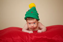 Little cute baby with christmas tree hat Stock Photography