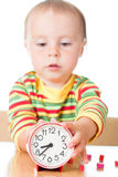 Little cute baby with clock Royalty Free Stock Photography