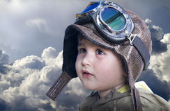 A little cute baby dreams of becoming a pilot Royalty Free Stock Images