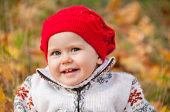 Little cute baby girl in autumn leaves Royalty Free Stock Images