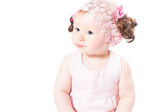 Little cute baby-girl with blue eyes  in pink dress isolated on white background. Use it for a child, parenting or love concept Royalty Free Stock Photos