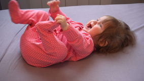 Little cute baby girl laughting playing with mom stock footage