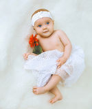 Little cute baby girl lying on a bed Stock Photo