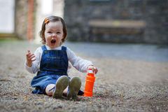 Little cute baby girl playing with soap bubbles in summer park Royalty Free Stock Image