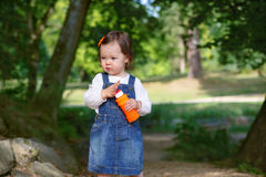 Little cute baby girl playing with soap bubbles in summer park Royalty Free Stock Photo