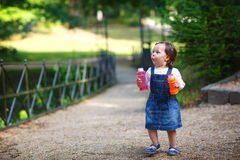 Little cute baby girl walking in summer park Royalty Free Stock Photography