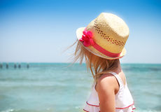 Little cute baby girl wearing hat on the beach Stock Photo