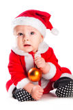 Little cute baby gnome in red with golden ball Stock Photos