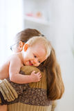 Little cute baby hanging mama Stock Photo