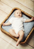 Little cute baby lying in basket Stock Photography