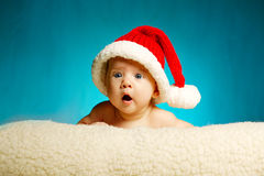Little cute baby with santa hat Stock Images