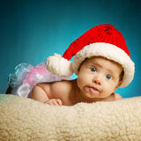 Little cute baby with santa hat Stock Photography