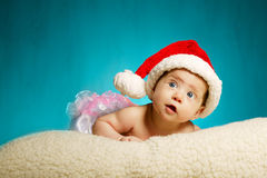 Little cute baby with santa hat looking up Royalty Free Stock Images