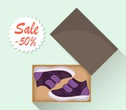 Little cute baby shoes in box, side view. Sale with a discount of 50 percent. Kid s casual violet boots. Illustration for a shoe s. Tore. Vector flat vector illustration