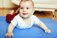 Little cute baby toddler on carpet close up smiling, adorable k Royalty Free Stock Photography
