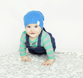 Little cute baby toddler on carpet isolated close up smiling adorable Stock Photos