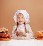 Little cute baker. Studio shot Stock Image