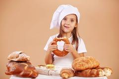 Little cute baker. Studio shot Royalty Free Stock Images