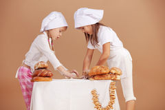 Little cute bakers Royalty Free Stock Photos