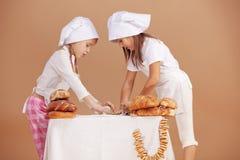 Little cute bakers. Studio shot royalty free stock photos