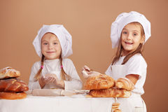 Little cute bakers Royalty Free Stock Photo
