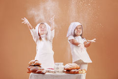 Little cute bakers. Studio shot Stock Images