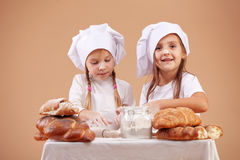 Little cute bakers Royalty Free Stock Images
