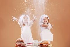 Little cute bakers. Studio shot royalty free stock photo