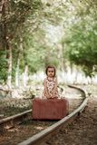 Little cute and beautiful caucasian girl in a vintage dress royalty free stock photos