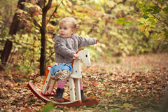 Little cute beautiful girl walks in autumn park Royalty Free Stock Image