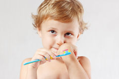 Little cute blond boy with toothbrush royalty free stock photography